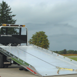 Flatbed truck with bed down for loading